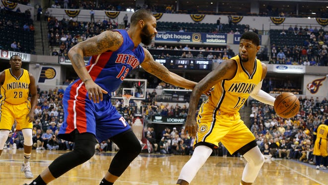 Indiana Pacers forward Paul George (13) was defended by Detroit Pistons forward Marcus Morris (13) at Bankers Life Fieldhouse.