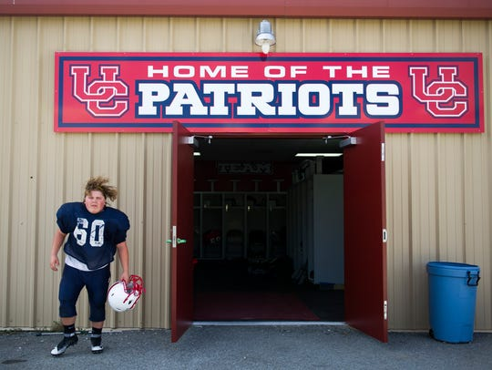 Bailee Linhares prepares for football practice at Union