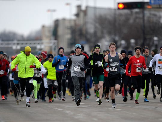 Runners and walkers participate in the 10th annual Seroogy's Valentine Run/Walk in De Pere on Saturday.