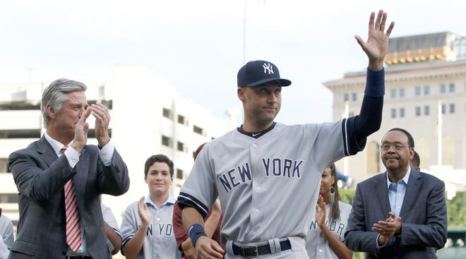Derek Jeter waves to the crowd Wednesday as  Detroit Tigers President and general manager David Dombrowski applauds during a pregame ceremony horning Jeter.