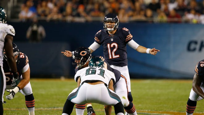 Chicago Bears quarterback David Fales (12) calls a play in the second half of an NFL preseason football game against the Philadelphia Eagles Friday, Aug. 8, 2014, in Chicago. (AP Photo/Charles Rex Arbogast)