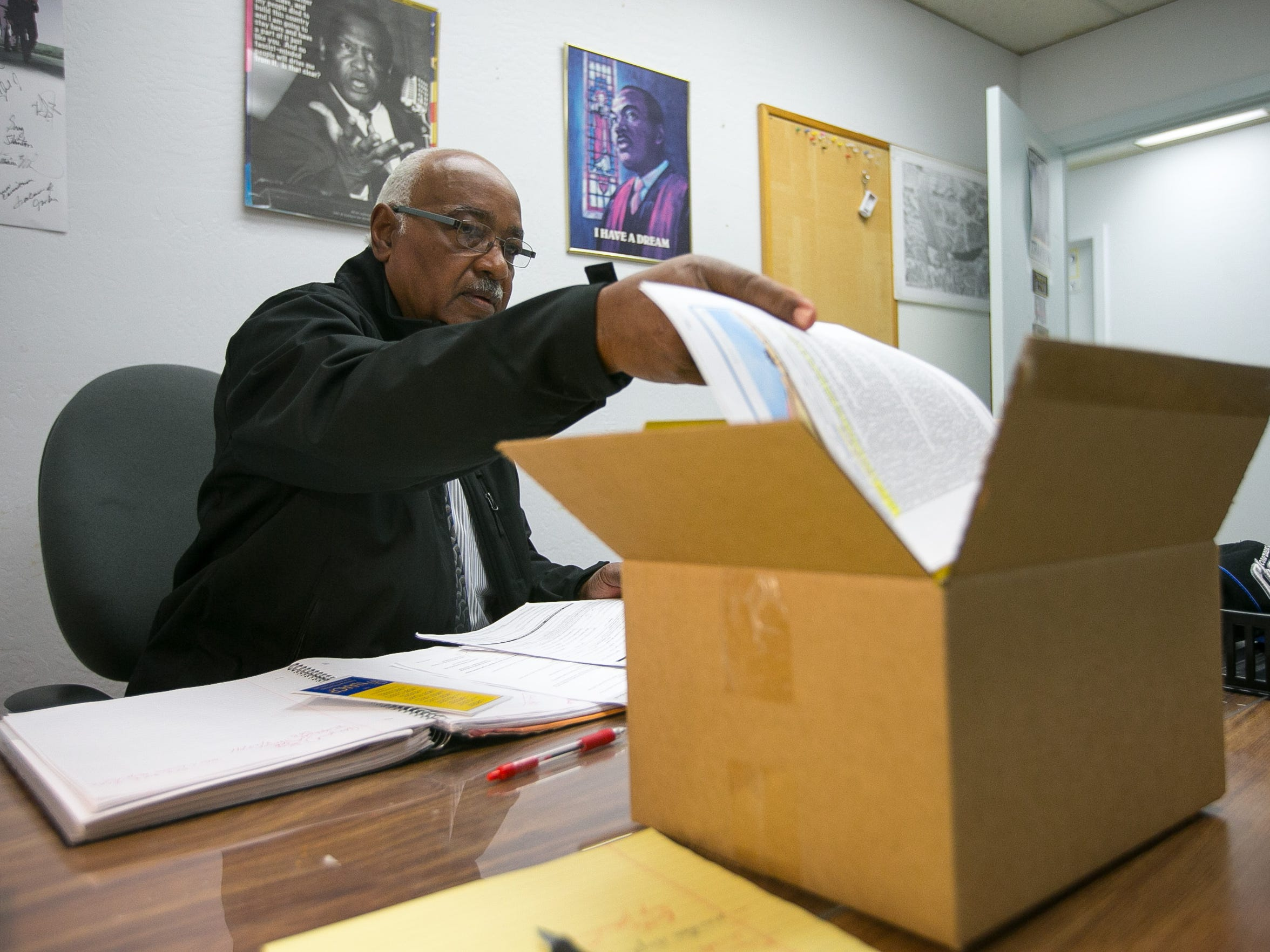 Reverend Oscar Tillman packs up his office during his