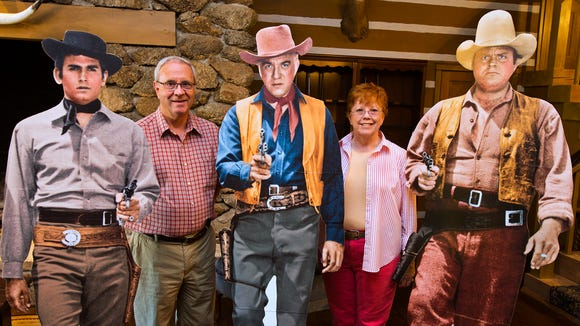 """Tom and Louise Swann bought the """"Ponderosa II"""" home in 2011.  The home, built by Bonanza actor Lorne Greene in 1963, is a replica of the set for the television series.  The Swanns are the third owners of the Mesa house.  Tom, second from left, and Louise, fourth from left, pose with cutouts of the famous actors."""