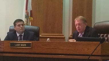Lee County Commissioners Brian Hamman, left and Larry Kiker during tax rate discussion Tuesday.