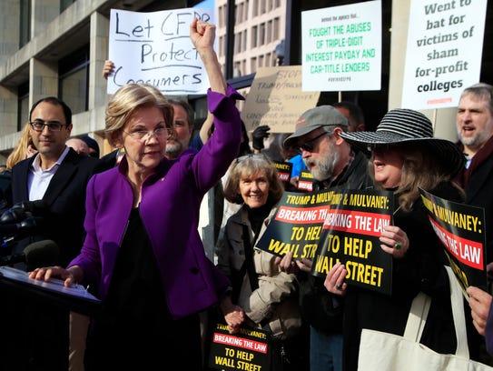 Sen. Elizabeth Warren, D-Mass., joins a rally outside