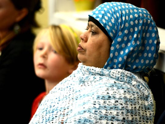"""Nur Jasan Becum sits and listens to speakers on Sunday at the Northern Nevada Muslim Community Center. Hundreds gathered as part of the """"I Am America"""" national movement."""