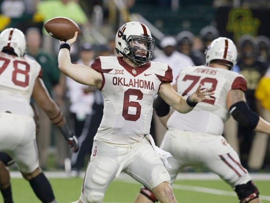 FILE - In this Sept. 23, 2017, file photo, Oklahoma quarterback Baker Mayfield (6) passes with coverage from offensive linemen Orlando Brown (78) and Ben Powers (72) during the second half of an NCAA college football game against Baylor in Waco, Texas. Mayfield has thrown for 1,635 yards and 15 touchdowns with no interceptions. Oklahoma faces Texas this week. (AP Photo/LM Otero, File)