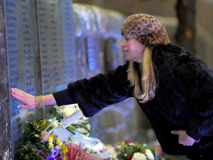 Relatives of those killed in the Lockerbie air disaster pay their respects at the 25th anniversary memorial service for the disaster at Dryfesdale Cemetery in Lockerbie, Scotland. Pan Am Flight 103 exploded over Lockerbie on Dec. 21, 1988, killing all those on board and 11 on the ground.
