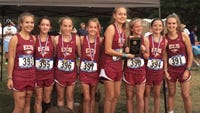 The ECS girls cross country team, coached by Jennifer McGillivray, celebrating after winning the Shelby League title.