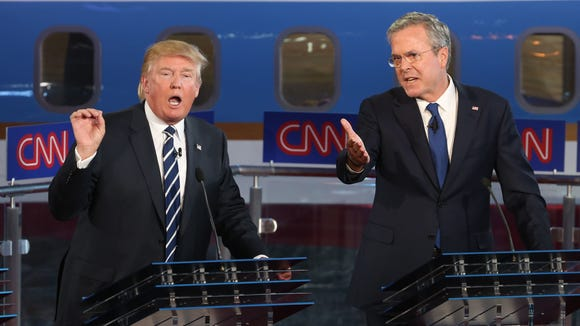 SIMI VALLEY, CA-SEPTEMBER. 16:  Republican presidential candidates Jeb Bush and Donald Trump take part in the presidential debates at the Reagan Library on September 16, 2015 in Simi Valley, California. Fifteen Republican presidential candidates are participating in the second set of Republican presidential debates.  (Photo by Justin Sullivan/Getty Images)