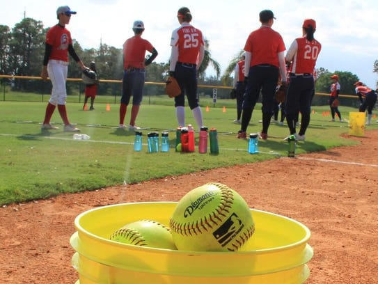 The Chinese fast-pitch softball team played in a summer