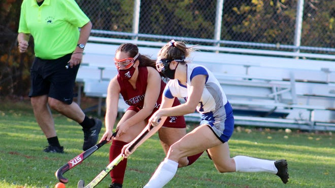 Narragansett's Olivia Narkevicius, right, battles for the ball with Fitchburg's Aleysha Santos during Wednesday's game at Arthur L. Stuart Memorial Field in Baldwinville. Narkevicius scored all three goals in the Warriors' 3-2 win over the Red Raiders.