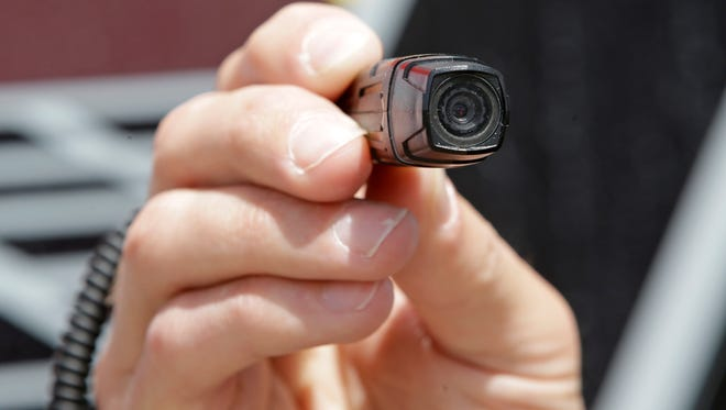 A West Valley City (Utah) Police sergeant demonstrates the use of a body camera.