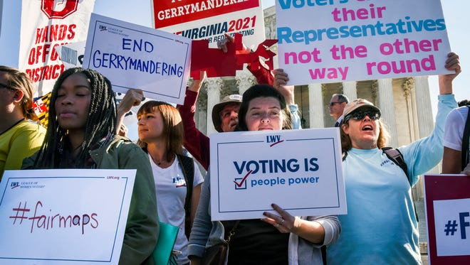 People protest gerrymandering outside the Supreme Court while the justices hear oral arguments on Oct. 3 in Washington, D.C.