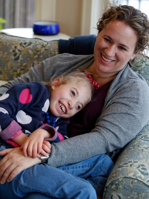 Kate Hintz and her daughter, Morgan Jones, 5, at home in North Salem. Morgan suffers from seizures and has tried more than a dozen epilepsy medications. Her family hopes to get access to medical marijuana.