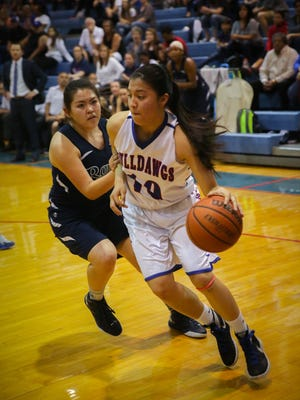 Las Cruces High's Val Valtierra beats Rio Rancho's Michele Garcia during Friday's Class 6A first round game at LCHS.