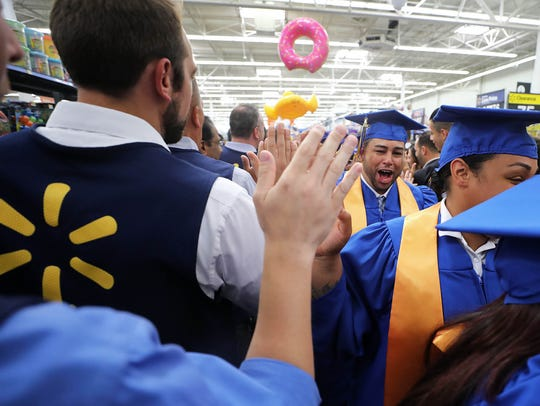 The procession line of Walmart graduates make their