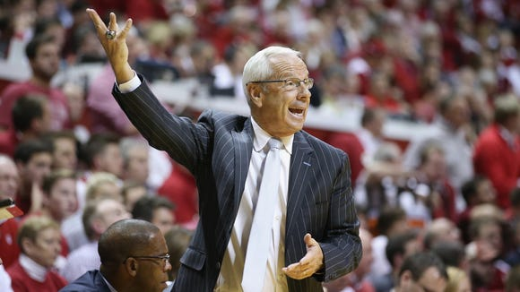 Roy Williams the head coach of the North Carolina Tar Heels gives instructions to his team during the game against the  Indiana Hoosiers at Assembly Hall on November 30, 2016 in Bloomington, Indiana.