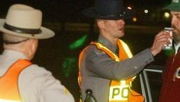 A trooper at Maryland State Police observes a Salisbury Police Department officer administer a breath test during a sobriety check. For two weeks starting Feb. 13, MSP arrested nine motorists in the Salisbury area for DUI.