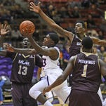 ULM's defense collapses on Northwestern State guard Zeek Woodley during Thursday's game.