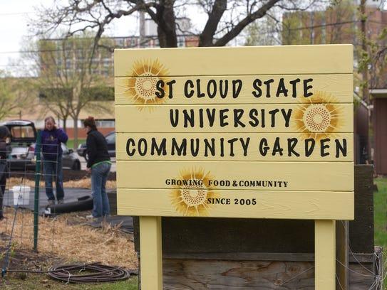 People work at planting Saturday, May 12, at the community