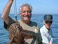 George Hill and Pete Foraker hold an anglerfish caught