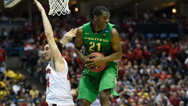 Damyean Dotson, pulling down a rebound against Wisconsin in the NCAA tournament, will not return to play for the Ducks.
