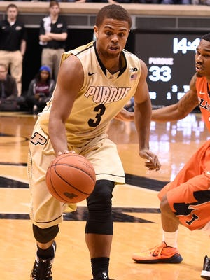 Mar 7, 2015; West Lafayette, IN, USA; Purdue Boilermakers guard P.J. Thompson (3) dribbles past Illinois Fighting Illini guard Jaylon Tate (1) in the second half at Mackey Arena. Purdue defeated Illinois 63-58. Mandatory Credit: Sandra Dukes-USA TODAY Sports