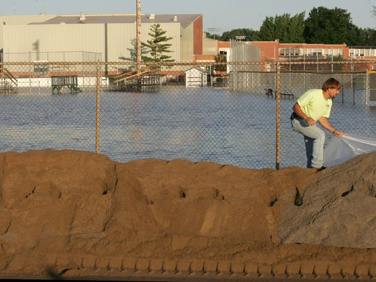A breach in the levee near North High School brought crews out in droves to build a quick barrier in 2008. North High was inundated with water during the flood.