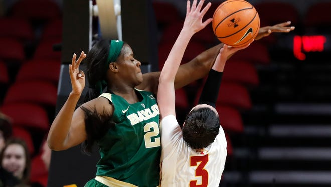 Baylor center Kalani Brown tries to block a shot by Iowa State guard Emily Durr (3) during the first half of an NCAA college basketball game, Wednesday, Jan. 17, 2018, in Ames, Iowa. (AP Photo/Charlie Neibergall)