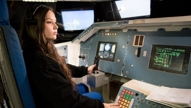 Addie Bell leads Team Innovation in a training mission during the Honeywell Leadership Challenge Academy at the U.S. Space and Rocket Center in Huntsville, Alabama.