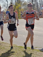 Plymouth junior Ethan Byrnes (left) and Northville's