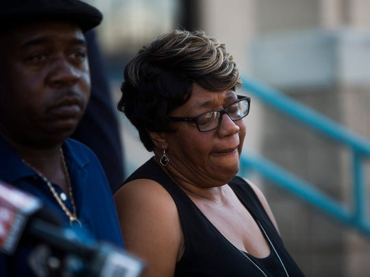 Johnnie Mae Grove, mother of the late Ricky Grove, cries for her son during a news conference Thursday.