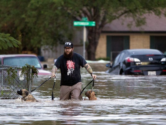 Halloween storms flood texas on tear across usa more than 100 people were rescued in austin as severe weather swept across us midsection texas flooding publicscrutiny Image collections