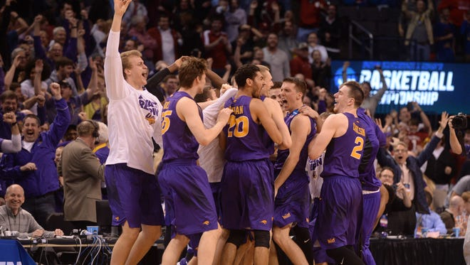 The Northern Iowa Panthers celebrate after defeating the Texas Longhorns 75-72 in the first round of the 2016 NCAA Tournament at Chesapeake Energy Arena.