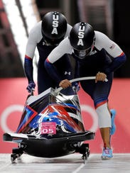 Driver Elana Meyers Taylor and Lauren Gibbs of the United States start their third heat during the women's two-man bobsled final at the 2018 Winter Olympics in Pyeongchang, South Korea, Wednesday, Feb. 21, 2018. (AP Photo/Wong Maye-E)