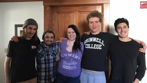 (From left) Eli Shepherd, Lucid Thomas, Holly Barton, Ross Floyd and Sean Haggerty remain inside the Nollen House, home to the office President Raynard Kington. Roughly 150 Grinnell College students particapted in a sit-in Friday urging Kington to endorse divesting the portion of Grinnell College's endowment in fossil fuels. These five students remain at Nollen House until Monday at 8 a.m. when they will be escorted out by police.