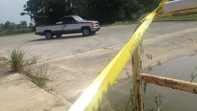 A pickup truck was pulled from the murky water after vandals drove it into a flooded loading dock at New Shiloh Christian Center.