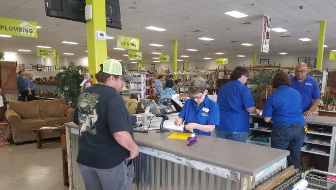 Grand opening attendees check out at the new ReStore.
