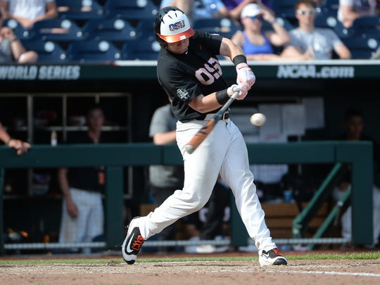 Jun 16, 2018; Omaha, NE, USA; Oregon State Beavers designated hitter Kyle Nobach (28) drives in a run in the seventh inning against the North Carolina Tar Heels during the College World Series at TD Ameritrade Park. Mandatory Credit: Steven Branscombe-USA TODAY Sports