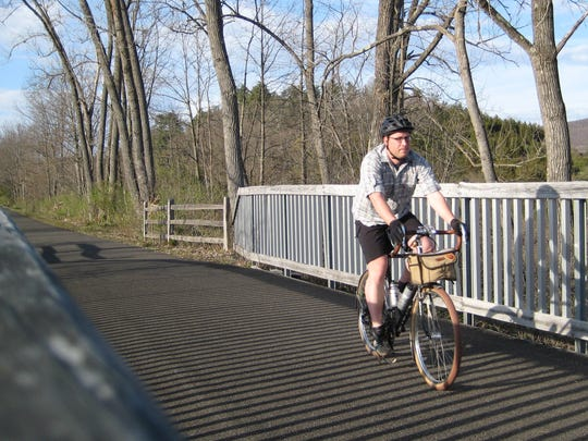 Patrick Oehler rides his bicycle on the Harlem Valley Rail Trail near Millerton on April 14, 2012.