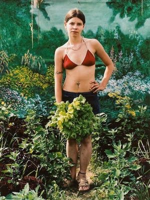 """Ashley Holding Lettuce,"" from the series ""One Farm; One Decade,"" by Dana Matthews."