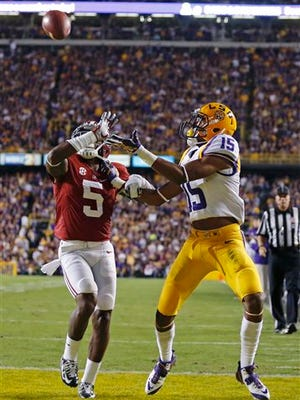 LSU wide receiver Malachi Dupre (15) pulls in a touchdown reception in front of Alabama defensive back Cyrus Jones (5) during last year's game.