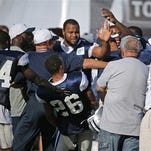 With Jeremy Mincey trying to block, Dallas Cowboys wide receiver Dez Bryant, hidden at right, swings at defensive back Tyler Patmon (26) as Bryant confronted Patmon after a rough play during the Cowboys afternoon practice at their 2015 training camp in Oxnard, Calif., Sunday.