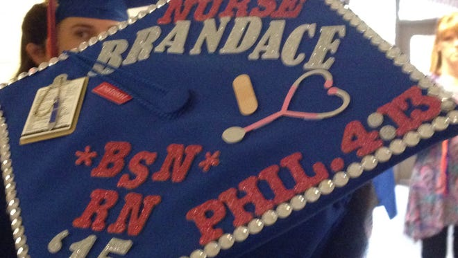 Brandace Latin decorated her mortarboard to commemorate her graduation on Saturday from Louisiana College's accelerated nursing program. The Shreveport resident already has a job lined up back at home.