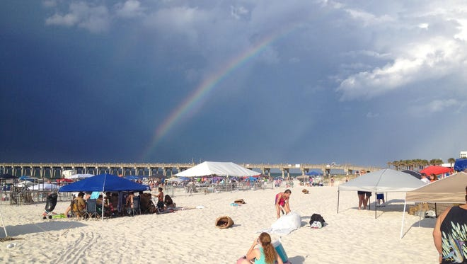 A rainbow forms over Pensacola Beach on Saturday, July 8, 2017.