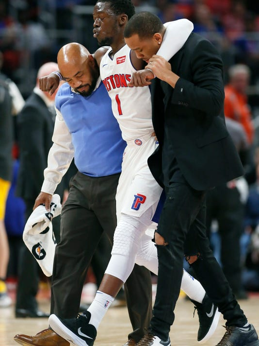 Detroit Pistons guard Reggie Jackson (1) is helped off the court during the second half of an NBA basketball game against the Indiana Pacers and did not return to the game, Tuesday, Dec. 26, 2017, in Detroit. The Pistons defeated the Pacers 107-83. (AP Photo/Duane Burleson)