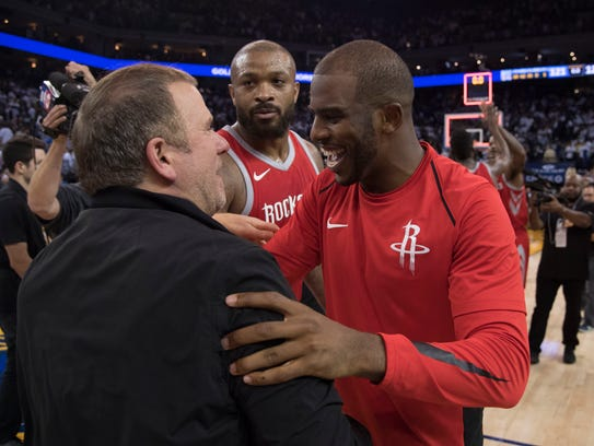 Houston Rockets owner Tilman Fertitta (left) celebrates