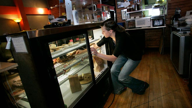 Nora Asplund will be manager of Brewed Awakenings which returns to downtown Appleton on Monday. (2010 photo)