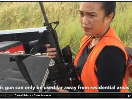 This screenshot from a Pacific Daily News video about hunting shows Chanel Salazar with an M4 rifle. Hunting with high-powered rifles is only allowed in certain areas, according to the Department of Agriculture's law enforcement division. A police reservist was arrested on suspicion of illegal hunting with a similar weapon on Jan. 18, 2016.